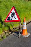 Triangular red and white road hazard warning sign with hi vis rubber traffic cone marking road maintenance works in County Down in. Triangular red and white road stock image