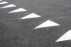 Triangular road markings Stock Image
