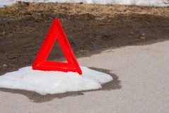 A red road sign on the ground royalty free stock image