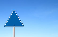 Triangular road sign with sky Stock Image
