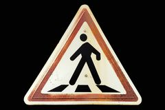 Triangular rusty ginger border road sign `Pedestrian crossing`. Isolated on black royalty free stock images