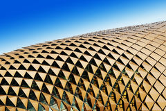 Triangular shades on roof. Triangular shades on the roof of the Esplanade Theatres by the Bay, Singapore, glowing with a golden hue as it is being lit by the Stock Photography