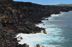 Rugged volcanic cliffs and coastline in Rapa Nui island Easter Island. The triangular-shaped Easter Island, or Rapa Nui, is of volcanic origin and in fact royalty free stock image