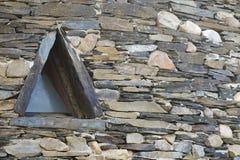 Triangular shaped slate window Stock Image