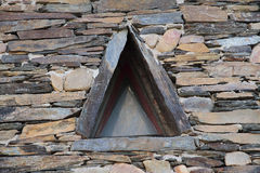 Triangular shaped slate window Royalty Free Stock Photography