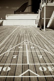 Triangular Shuffle Board Target. An image of a triangular shuffle board target on a wooden deck Stock Images