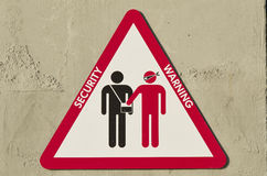 Triangular sign to warn about the risk of being robbed Stock Photography