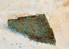 Triangular stone in a wall. Close up of a triangular stone in a wall Stock Photography