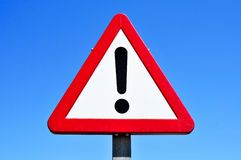 Triangular traffic sign with an exclamation mark Stock Images