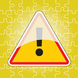 Triangular warning sign on puzzle Stock Photo