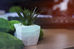 Triangulate background. Decorative flower pot on the table with royalty free stock photography