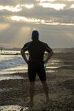 Triathlete on beach. Stock Image