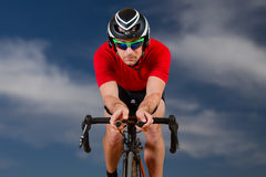 Triathlete on a bicycle Stock Image