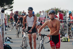 Triathlete Bikers Approaching Starting Line Stock Images