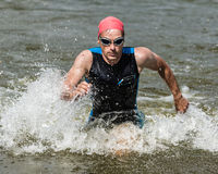 Triathlete comming out ot the water Royalty Free Stock Photo