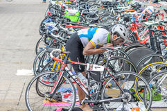 Triathlete in the cycle transition Royalty Free Stock Images
