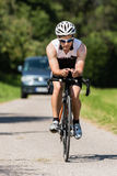 Triathlete in cycling Stock Images