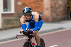 Triathlete in cycling leg of Nottingham outlaw triathlon. Triathlete on cycle in Nottingham ironman event Sept 2015 Royalty Free Stock Photo