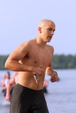 Triathlete Exiting Water Royalty Free Stock Images