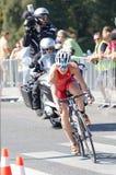 Triathlete flor Duffy kolarstwo, podążać filmuje drużyny Fotografia Stock