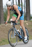 Triathlete Heather Wurtele. Of Kelowna, BC, Canada shown here on the bike portion of the Ironman Triathlon Royalty Free Stock Images