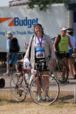 A triathlete and her bike after a race Stock Photos