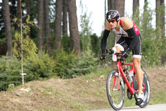 Triathlete James Bonney. Of Austin, TX shown here on the bike part of the ironman triathlon Stock Images