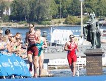 Triathlete Margit Vanek and comptitors  running Royalty Free Stock Image