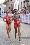 Triathlete Miriam Casillas Garcia running, followed by Elena Dan. STOCKHOLM - AUG 22, 2015: Triathlete Miriam Casillas Garcia running, followed by Elena Danilova royalty free stock photo