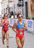 Triathlete Miriam Casillas Garcia running, followed by Elena Dan. STOCKHOLM - AUG 22, 2015: Triathlete Miriam Casillas Garcia running, followed by Elena Danilova stock image