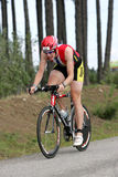 Triathlete Rob Steegink. Of Holten, Netherlands shown here on the bike part of the ironman triathlon Royalty Free Stock Photo