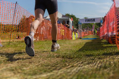 Triathlete runner finish line Stock Images