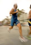 Triathlete running. On the road with panning blur Royalty Free Stock Photo