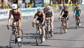 Triathlete Sarah True leading a group of cyclists Royalty Free Stock Photo