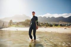 Triathlete in training at the beach Stock Photo