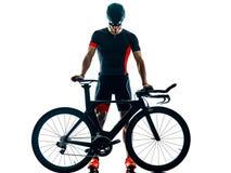 Triathlete triathlon cyklisty kolarstwa sylwetka odizolowywa? bia?ego t?o zdjęcia stock