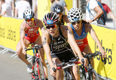 Triathlete Yuko Takahashi cycling, followed by competitors Stock Photo