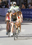 Triathlete Yuko Takahashi cycling, followed by competitors Royalty Free Stock Photos