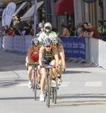 Triathlete Yuko Takahashi cycling, followed by competitors Royalty Free Stock Photography