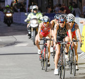 Triathlete Yuko Takahashi cycling, followed by competitors Stock Image