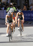 Triathlete Yuko Takahashi cycling, followed by competitors Royalty Free Stock Photography