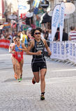 Triathlete Yuko Takahashi running, followed by competitors Stock Image