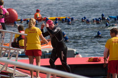 Triathletes end the swin stage of a London triathlon Stock Photo