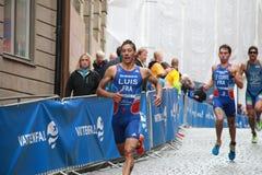Triathletes Pierre Le Corre, Vincent Luis och Alessandro Fabian Arkivfoto