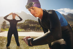 Triathletes practicing for race Royalty Free Stock Image