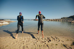 Triathletes practicing for triathlon competition Royalty Free Stock Image