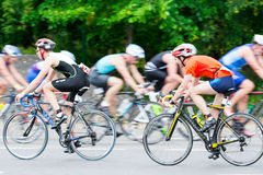 Triathletes ride speed cycles back and forth during triathlon competition. In Moscow, Russia Stock Photo