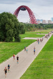 Triathletes run during triathlon competition in Moscow with cable-stayed red Jivopisny Bridge behind Royalty Free Stock Image