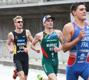 Triathletes running-2 Photos stock
