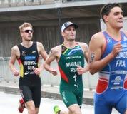 Triathletes running-2 Стоковые Фото